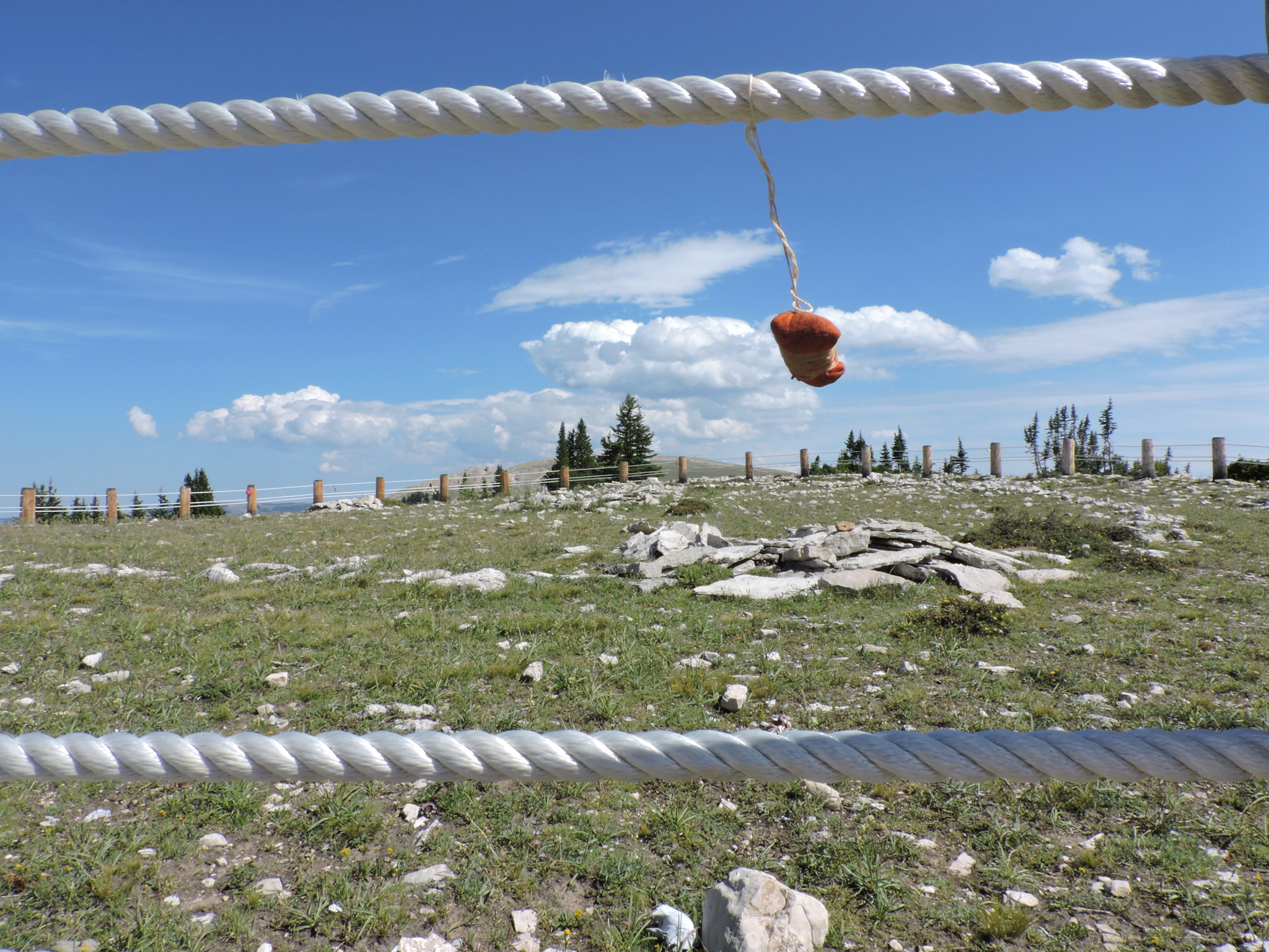 A prayer bundle left by a pilgrim dances in the Wyoming wind